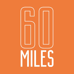 60 miles by road or rail logo