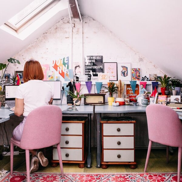 laura sat at her desk inside the studio